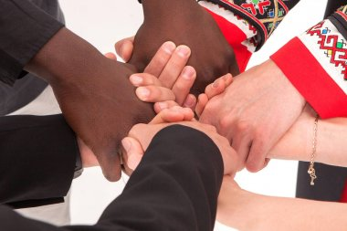 People of different nationalities and religions hold hands. The concept of friendship among peoples.