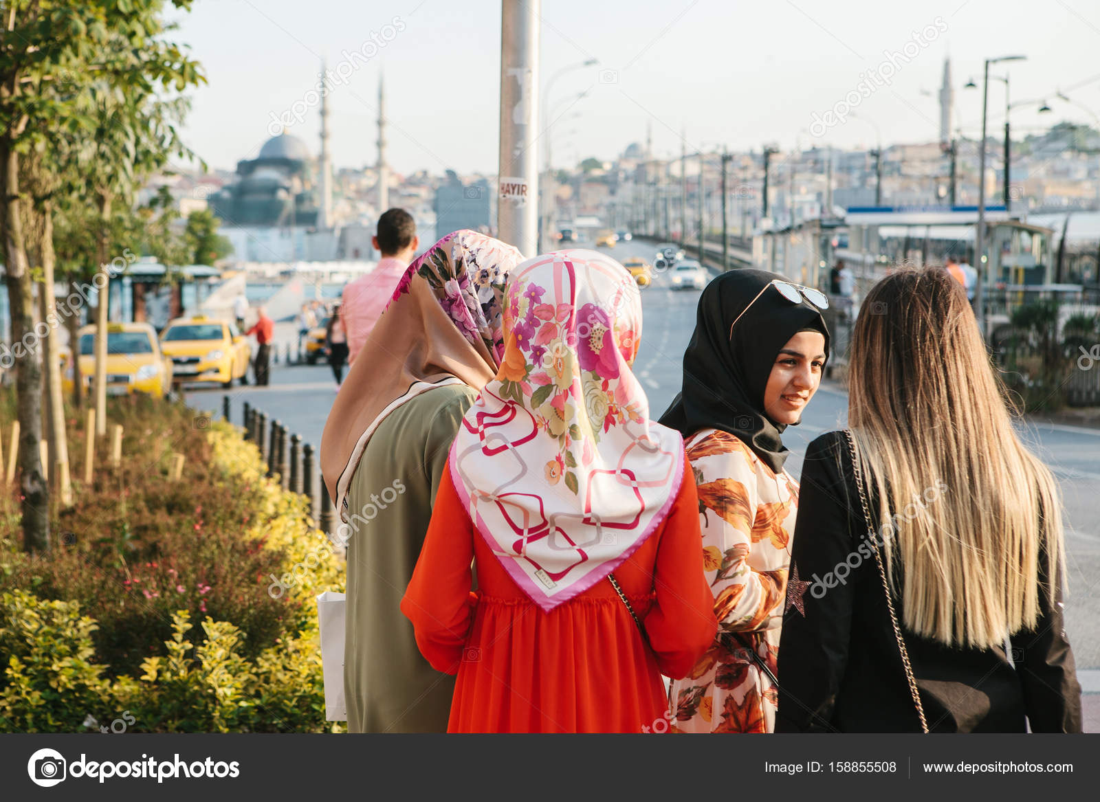 Istanbul, June 15, 2017: Islamic women in traditional attire communicate with each other