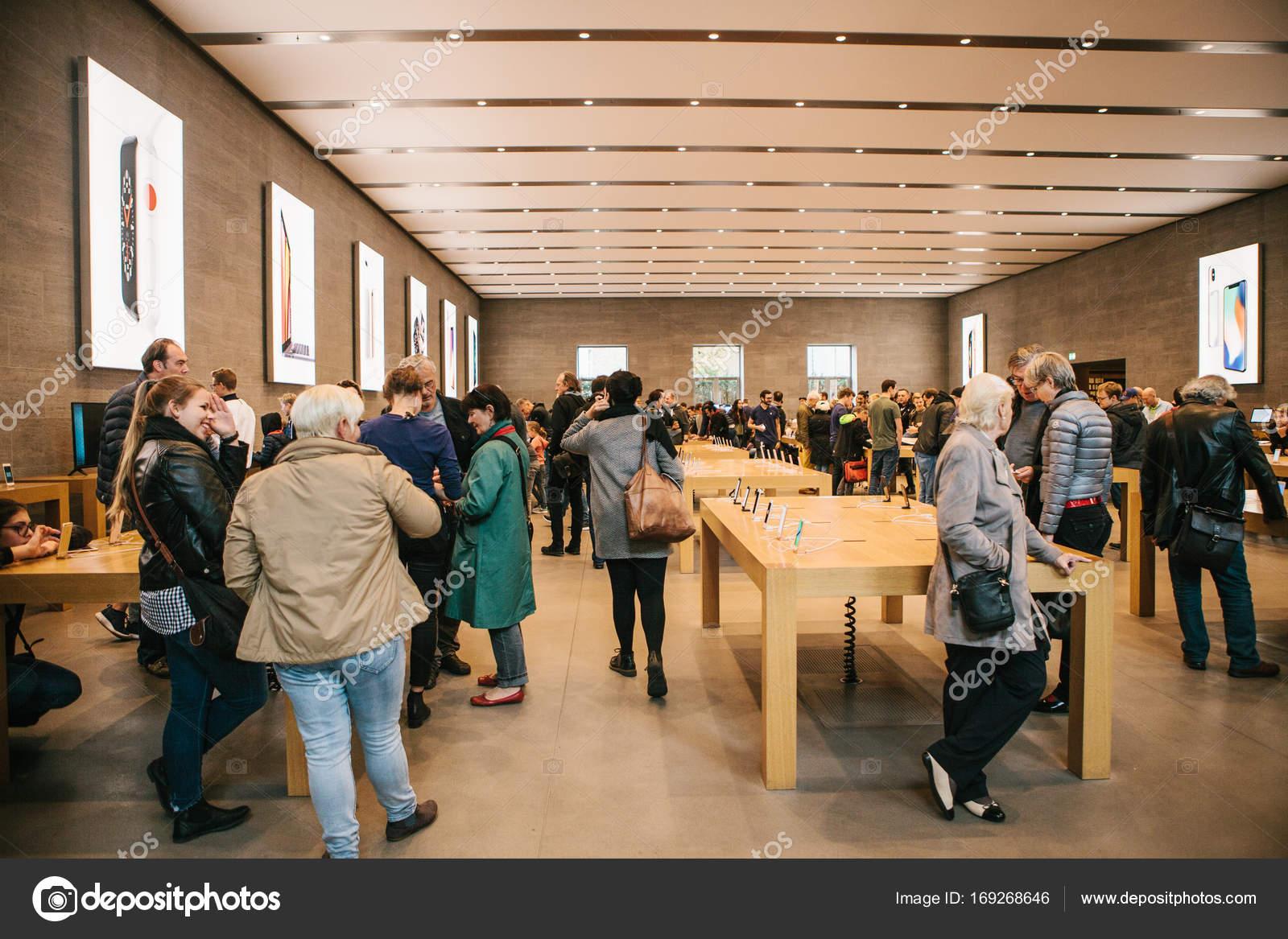Apple Store Berlin. An Apple Employee Hands Over Apple Iphone Phones ...