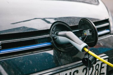 Berlin, October 1, 2017: The electric car is being charged at a special place for charging electric vehicles. A modern and eco-friendly mode of transport that has become widespread in Europe.