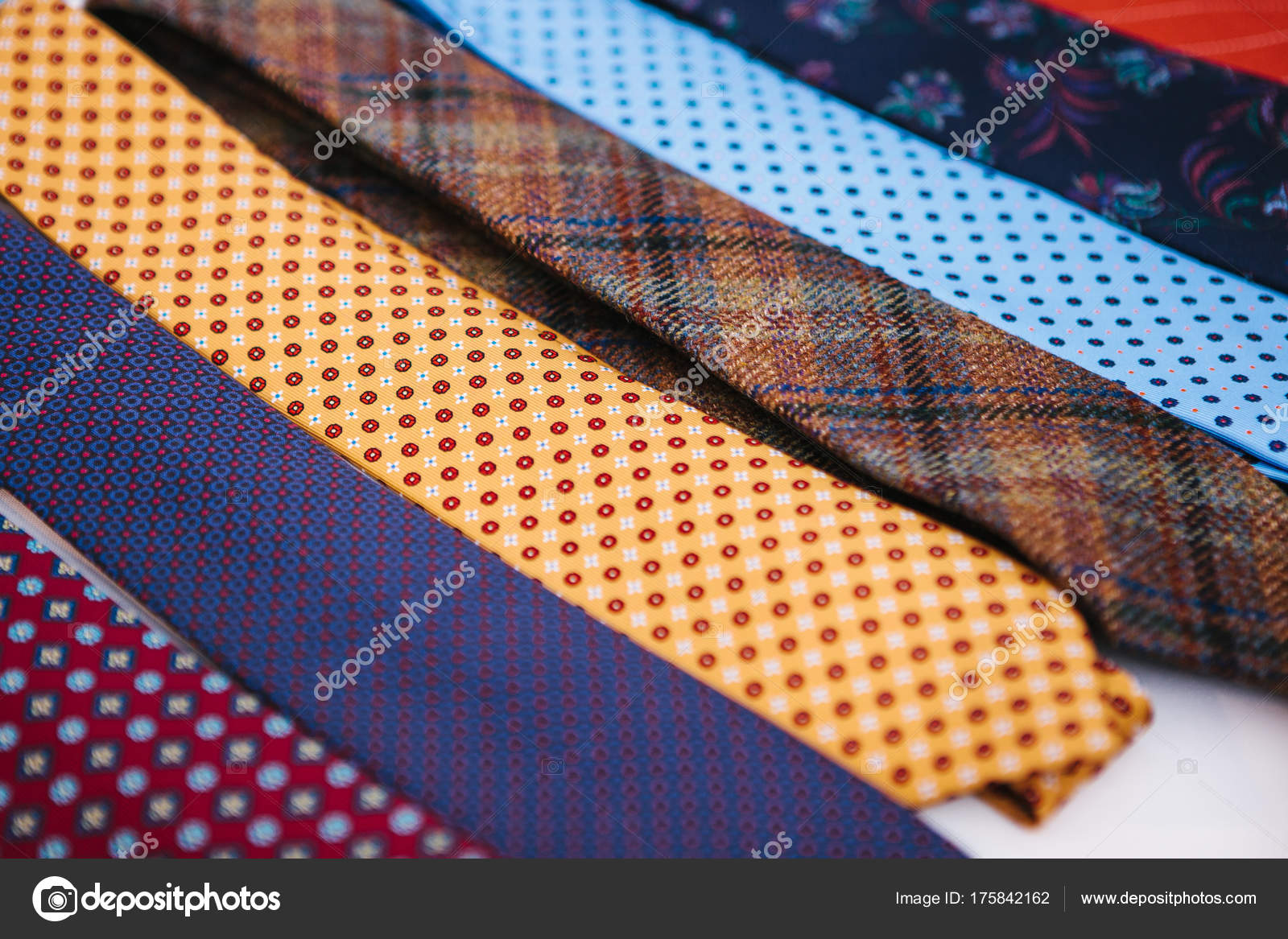 92115f42faebf Fashionable mens accessory.– stock image. Many multi-colored ties in a row.  Supplement to mens clothing in business style