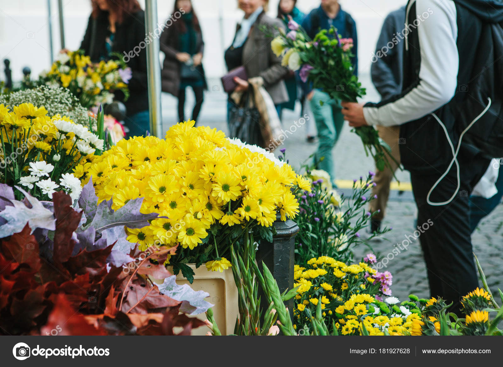 Street Flower Shop In The Foreground There Are Beautiful Yellow And