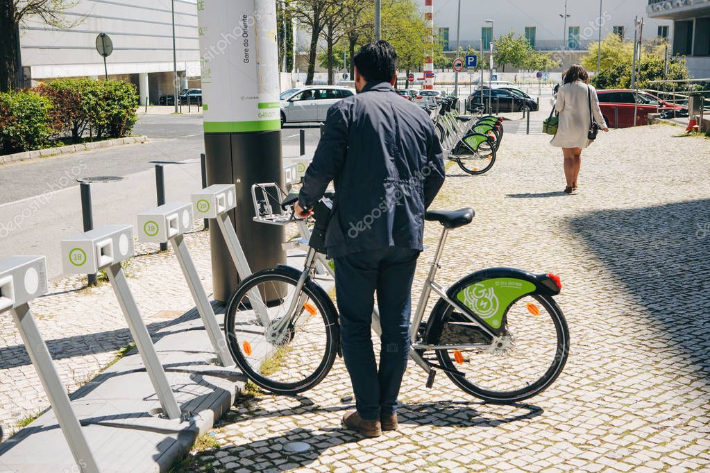 Portugal, Lisbon 29 april 2018: city bicycles or alternative ecological public transport. A person takes a bicycle for rent.