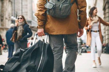 A tourist is walking along a street