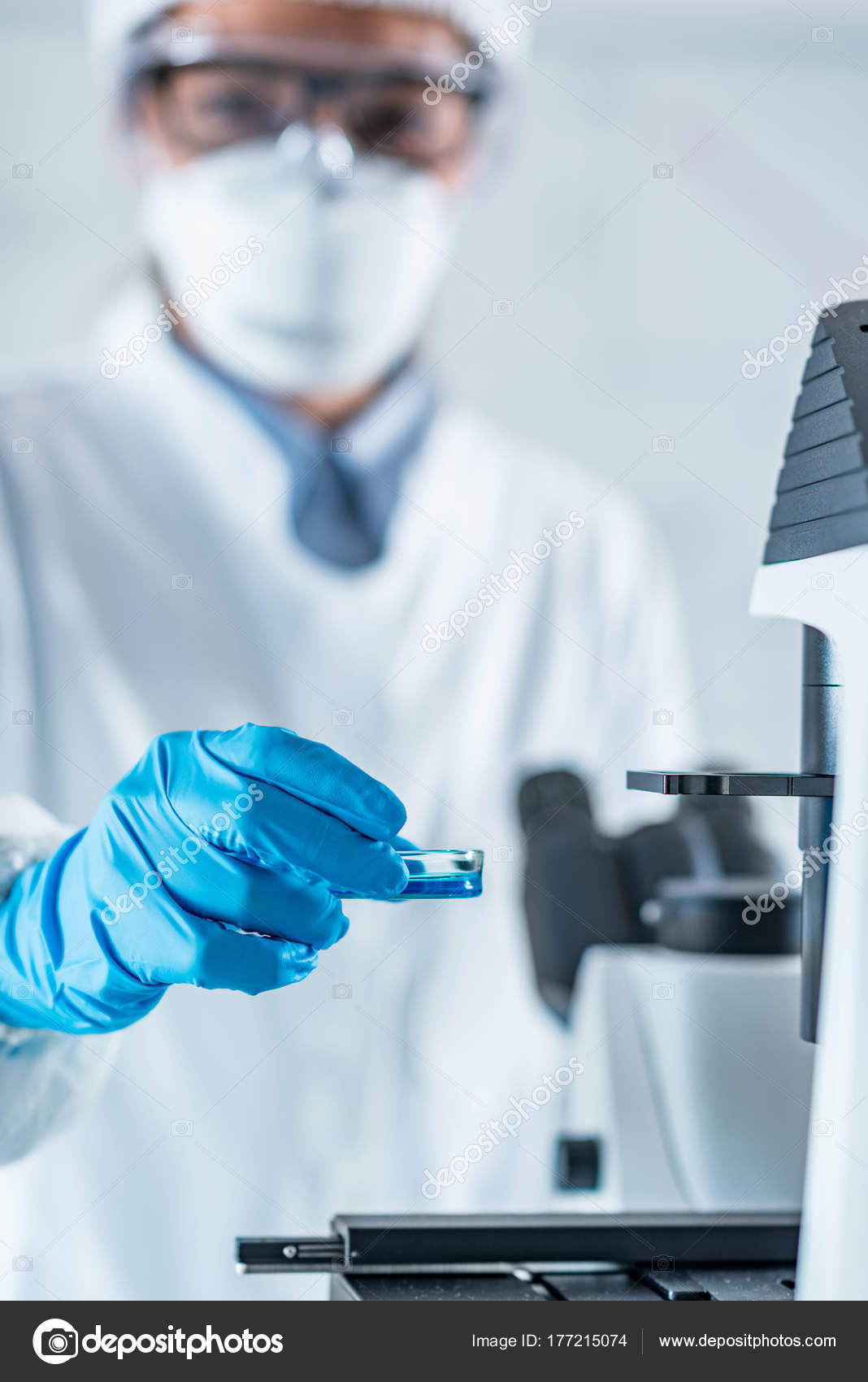Biotech Lab Research Technician Placing Petri Dish Cell Culture