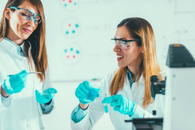 Female scientists working  in laboratory