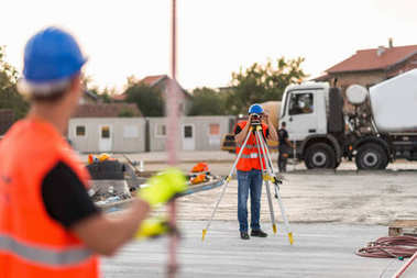 Surveyors working on construction site