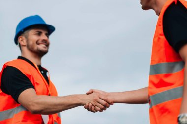 Construction Workers handshaking on Construction site stock vector