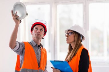 Maintenance Engineers on construction site checking light stock vector