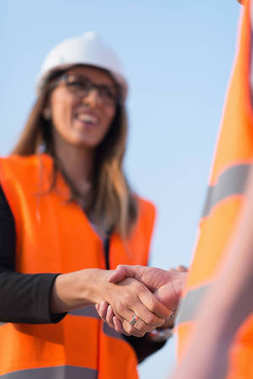 Architects handshaking after successful meeting on construction site stock vector
