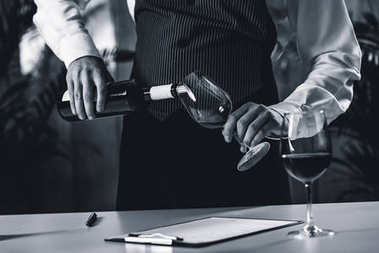 sommelier Pouring red wine from bottle