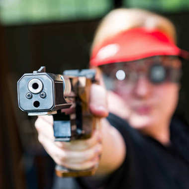 Woman concentrating on sport shooting training