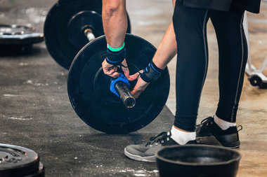 athlete Changing weights at Weightlifting competition