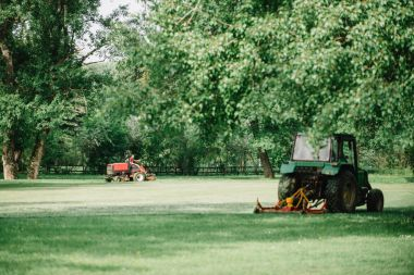 Golf course maintenance equipment, fairway mower on the background