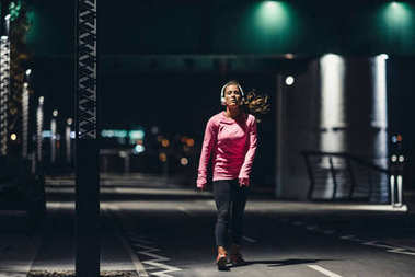 Female at late-night jogging outdoors