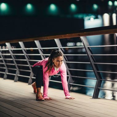 young woman Stretching after jogging