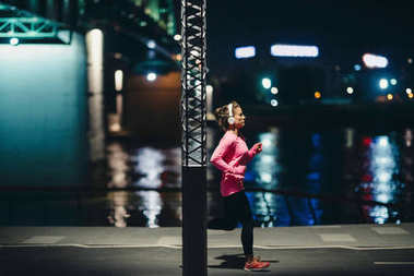 woman at Late night jogging outdoors