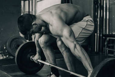 male athlete on weightlifting training