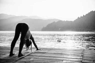 Female in Sun Salutation Pose by the lake