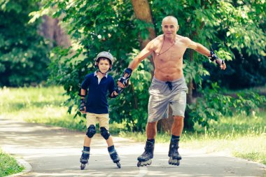 grandson Skating with grandpa in the park