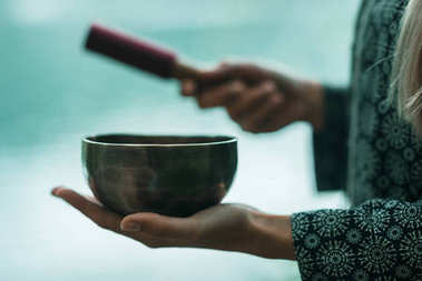 woman holding Tibetan singing bowl