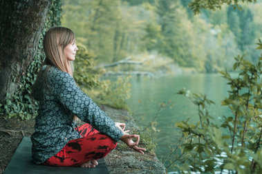 woman  doing mindful meditation