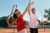 Női szolgálatot teniszlabda-tenisz-osztály