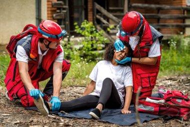 Rescue team helping injured victim
