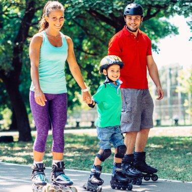 Portrait of family on roller skates in park