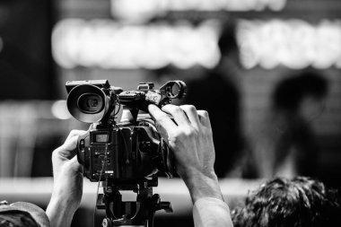 Close up of Cameraman recording event stock vector