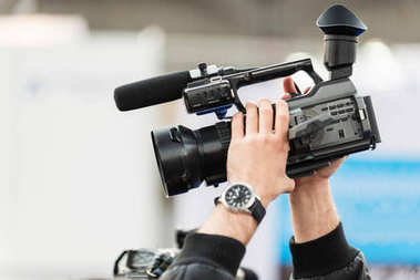 reporter Recording with tv camera