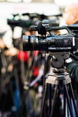 Video camera recording press conference
