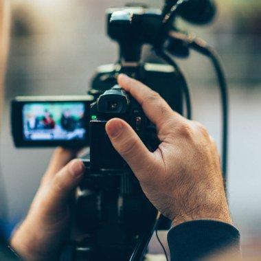 close up of Cameraman recording event