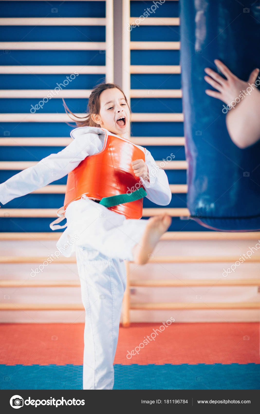 Child Kicking Punching Bag Tae Kwon Class — Stock Photo