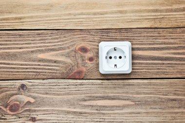 Power socket on wooden wall, minimalism