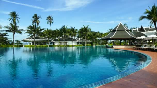 Sunbeds and umbrellas around  Swimming pool
