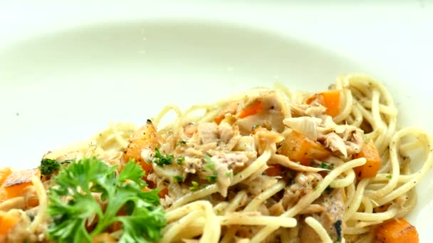 Spaghetti with tuna in white plate