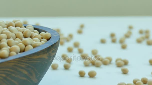 pile of raw soy beans in wooden bowl
