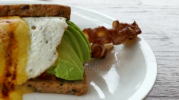delicious sandwich with fresh avocado and bacon