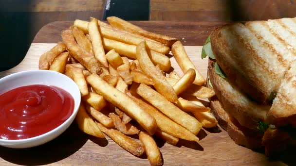 delicious sandwiches with ham and cheese and French fries, video