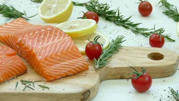 fresh raw salmon fillet with ingredients for cooking
