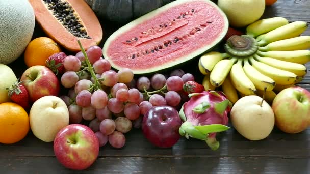 delicious assorted tropical fruits on wooden table