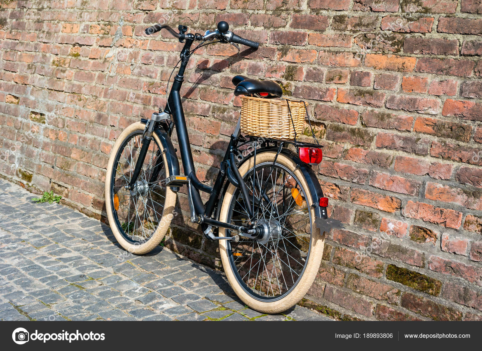 ea30e2155f3 Black retro vintage bicycle with old brick wall and copy space. Retro  bicycle with basket in front of the old brick wall. Retro bicycle on  roadside with ...
