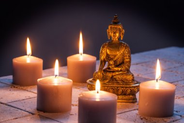 concept of mindfulness and buddhism with Buddha and lighted candles