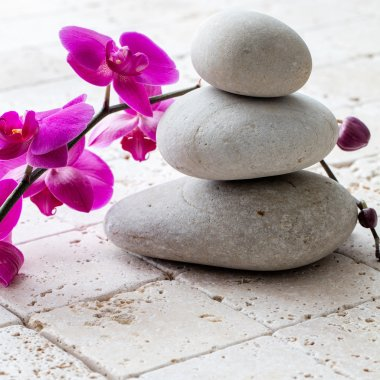 wellbeing, meditation and femininity with stack of balancing pebbles