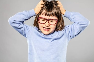 irritated young girl pulling out hair for itchy lice allergies
