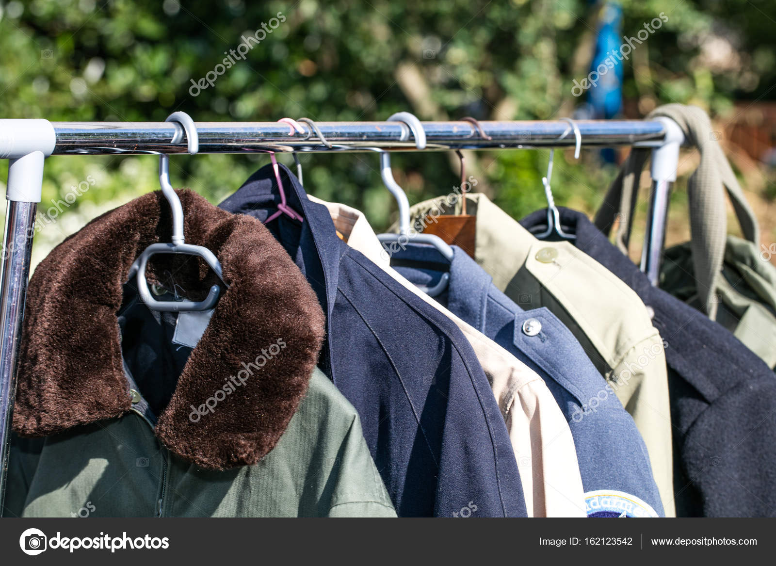 4fa2083c5 Coats and jackets on rack at thrift store to resale — Stock Photo ...