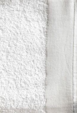 macro of clean textured white soft cotton towel for cleanliness