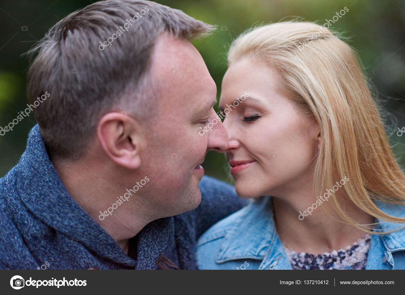 mature couple closed to kiss — stock photo © mavoimages #137210412