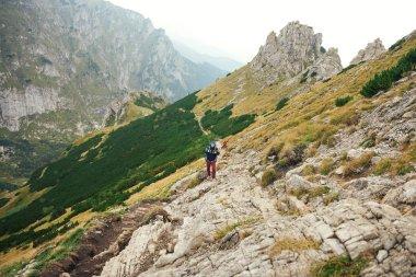 men walking together along a rugged trail